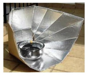 Homemade solar cooker constructed from foil surfaced cardboard.