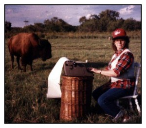 Publicity photo of Janice VanCleave typing in a field with a Buffallo nearby.