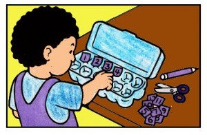 A boy is learning to count to twelve and recognize the nunbers by placing them in an empty  one-dozen egg carton.