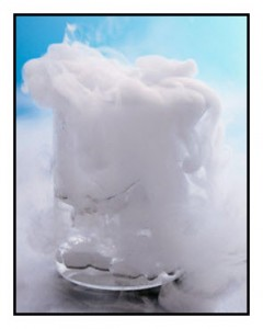 A beaker of water with chunks of dry ice create a billowing cloud of water vapor due to the sublimation of the dry ice. The cold gas causes water vapor in the air to condense into cloud droplets.