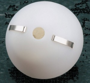 A ping-pong ball with a buzzer, light, and battery inside to teach closed and open series circuits.